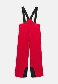 Kjus - BOYS VECTOR PANTS - Zimní kalhoty - scarlet - 1