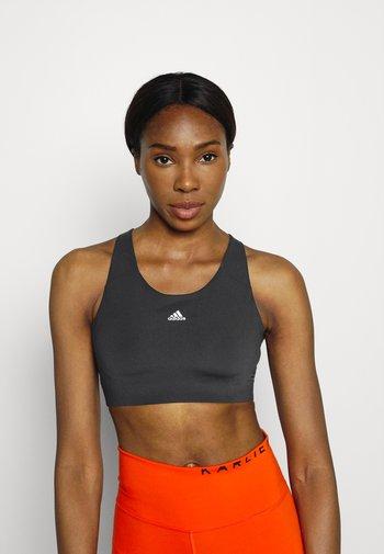 ULTIMATE ALPHA - High support sports bra - black/white