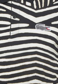 Lacoste - LACOSTE X NATIONAL GEOGRAPHIC - Polo shirt - black/white - 7