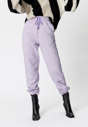 RUBI - Tracksuit bottoms - pastel lilac