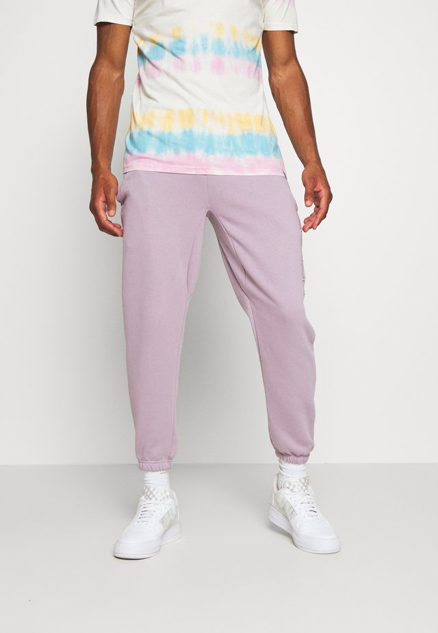 OUTLINE - Tracksuit bottoms - lilac