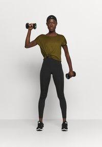 Nike Performance - DRY ELASTIKA - Camiseta de deporte - olive flak/volt/black - 1