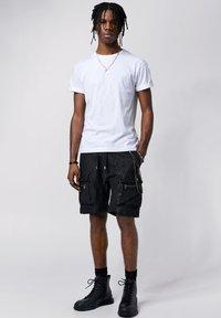 Tigha - Shorts - black - 1