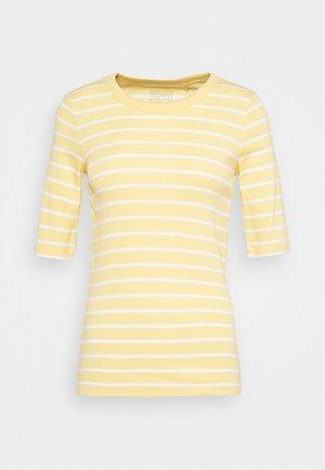 FLOW CORE - Print T-shirt - sunflower yellow