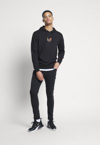 Golden Equation - FADED DISTRESSED MID-RISE - Jeans Skinny Fit - black - 1