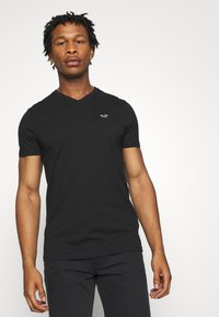 Hollister Co. - SOLIDS  - Basic T-shirt - black - 0
