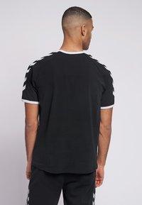 Hummel - JIMMY - Print T-shirt - black - 2