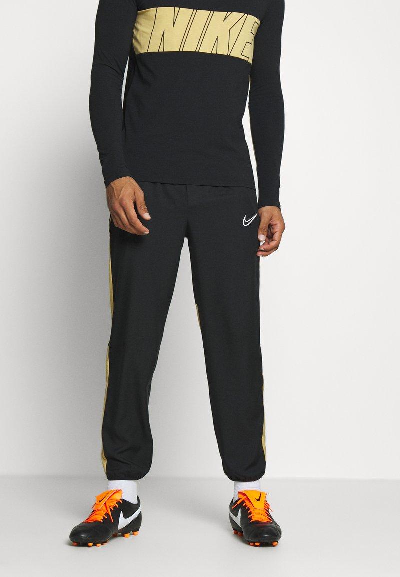 Nike Performance - DRY ACADEMY PANT - Verryttelyhousut - black/jersey gold/white