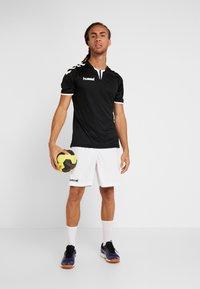Hummel - CORE SHORTS - Sports shorts - white - 1