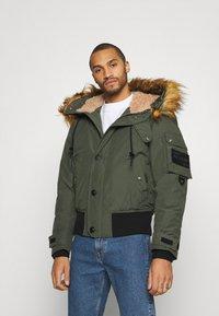 Diesel - W-JAME JACKET - Winter jacket - olive - 0