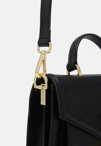Ted Baker - KIMMIEE LUGGAGE LOCK MINI SATCHEL - Across body bag - black - 3