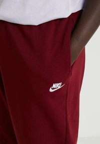 Nike Sportswear - PANT - Tracksuit bottoms - team red/white - 4