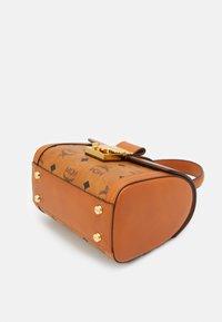 MCM - TRACY VISETOS SATCHEL SMALL - Handbag - cognac - 4