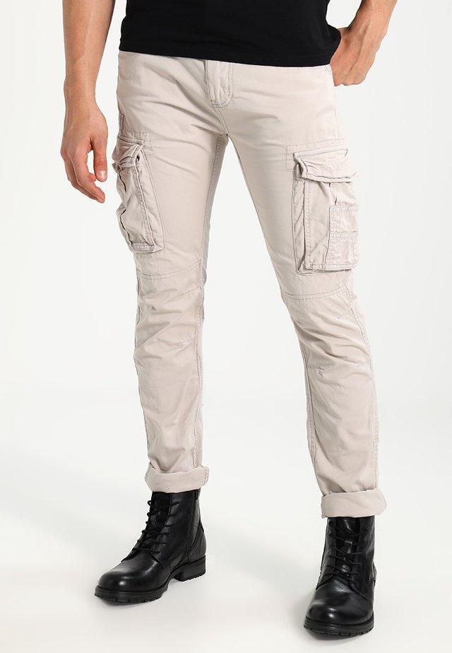 TRRANGER - Cargo trousers - beige