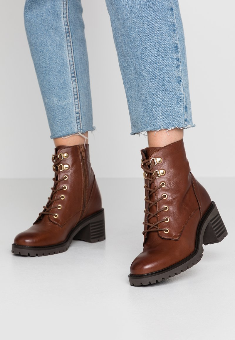 KIOMI - Lace-up ankle boots - brown