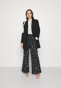 Fabienne Chapot - PUCK TROUSER - Trousers - black/warm white - 1