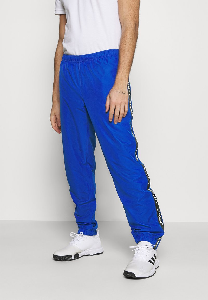 Lacoste Sport - TENNIS PANT TAPERED - Tracksuit bottoms - lazuli/black/white