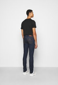MOSCHINO - TROUSERS - Slim fit jeans - fantasy blue - 2