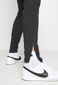 Nike Performance - DRY STRIKE WINTERIZED - Tracksuit bottoms - black/volt - 5