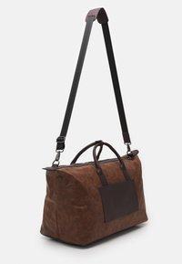 ALDO - VOLKODAV - Weekend bag - dark brown - 1