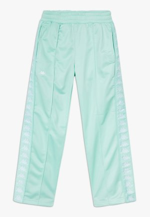 GELANIA - Tracksuit bottoms - yucca