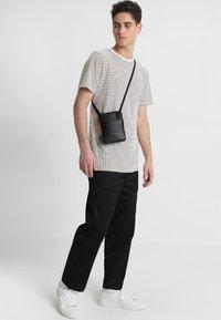Still Nordic - CLEAN MINI - Across body bag - black - 1