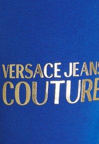 Versace Jeans Couture - PANTS - Tracksuit bottoms - blue - 5