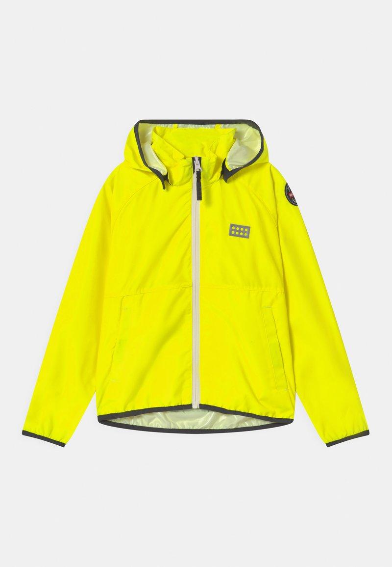 LEGO Wear - JORI 201 JACKET UNISEX - Waterproof jacket - neon yellow