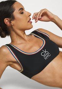 Calvin Klein Swimwear - PRIDE EDIT BRALETTE - Bikini top - black - 5