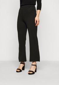 Even&Odd Petite - Flared PUNTO trousers - Leggings - black - 0
