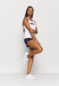 Puma - TRAIN LOGO CROSS BACK TANK - Sports shirt - white - 1