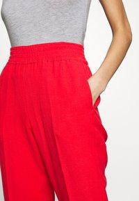 Sisley - TROUSERS - Pantaloni - red - 4