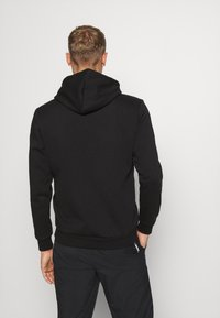 Puma - AMPLIFIED HOODIE - Sweat à capuche - black - 2