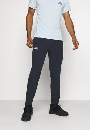 TENNIS PANT - Tracksuit bottoms - blue/white