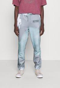 Blood Brother - SLOGAN TIE DYE JOGGERS UNISEX - Pantalon de survêtement - mint - 0
