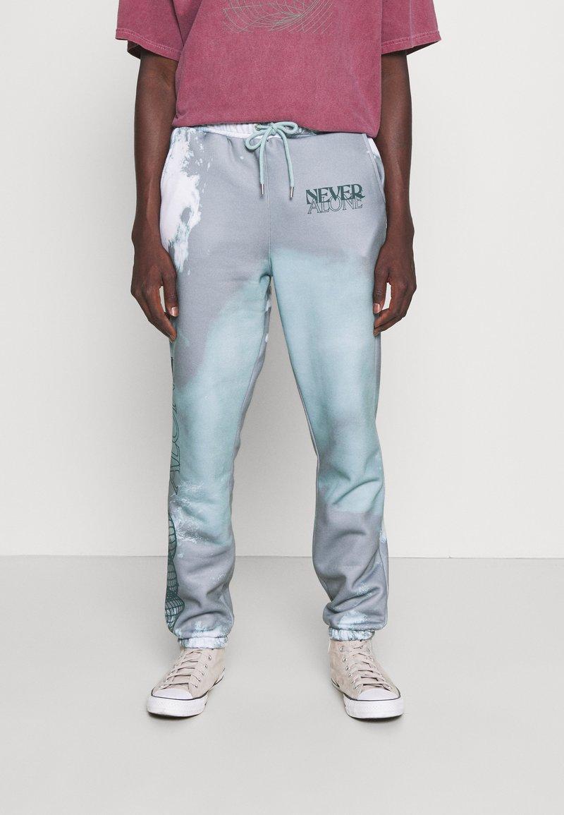 Blood Brother - SLOGAN TIE DYE JOGGERS UNISEX - Pantalon de survêtement - mint