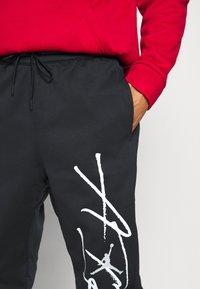 Jordan - AIR THERMA PANT - Teplákové kalhoty - black/white - 4