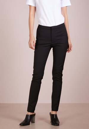 CRISTIN - Trousers - black