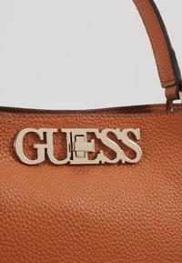 Guess - UPTOWN CHIC TURNLOCK SATCHEL - Handbag - cognac - 6