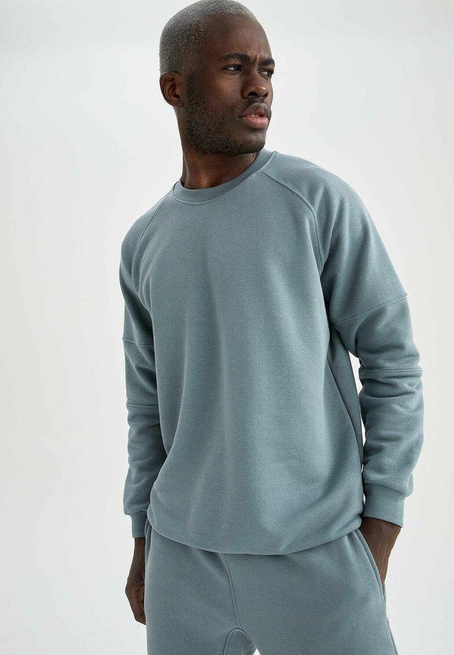 OVERSIZED - Sweatshirt - turquoise