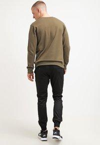 Volcom - FRICKIN SLIM FIT - Trousers - black - 2