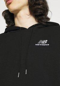New Balance - ESSENTIALS EMBROIDERED HOODIE - Sweatshirt - black - 5