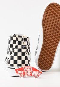 Vans - SK8 TAPERED - Sneakers hoog - black/true white - 7