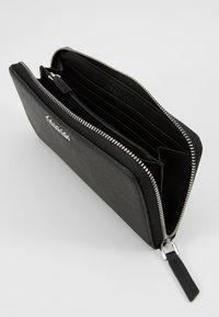 Calvin Klein - TASK ZIPAROUND - Peněženka - black - 5