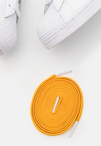 adidas Originals - SUPERSTAR SPORTS INSPIRED SHOES UNISEX - Trainers - footwear white/active gold - 5