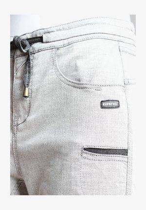AMELIE - Tracksuit bottoms - light grey
