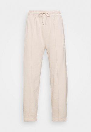 90'S BOW LEG - Teplákové kalhoty - cashew milk