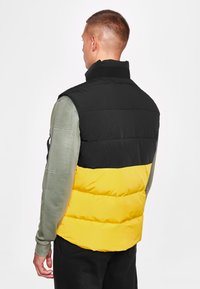National Geographic - Waistcoat - lemon chrome - 1