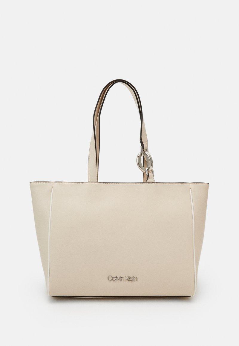 Calvin Klein - CHAIN SHOPPER - Handbag - beige