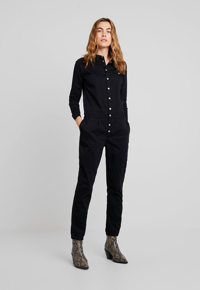 UNDER THE BOARDWALK - Jumpsuit - black